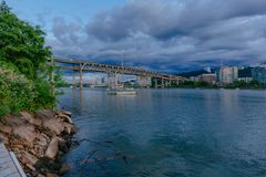 Marquam Bridge over Willamette River with boats in Portland, USA royalty free stock photo