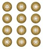Marque avec des lettres A à M sur les boucliers en bronze Photos stock