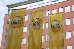 Marque avec des lettres l'arag sur des drapeaux Images stock