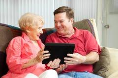 Marque en la tableta la PC para la madre fotos de archivo