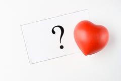Marque et coeur de question Image stock