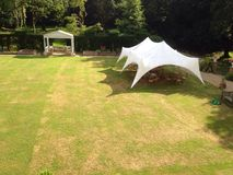 Marquee and Lawn Prestigious Garden. The marquee is used for social events and summer weddings on the lawn at the Landguard Manor in Shanklin on the Isle of Stock Photography