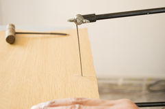 Marquetry craftsman his sawing board Royalty Free Stock Image