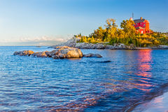 Marquette Harbor LIghthouse. The red Marquette Harbor Light is a lighthouse  situated on the rocky McCarty's Cove along the Lake Superior shore of Michigan's Stock Image