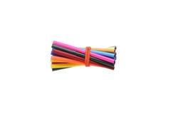 Marqueurs collés et crayons d'une bande élastique Images libres de droits