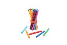 Marqueurs collés et crayons d'une bande élastique Photographie stock libre de droits
