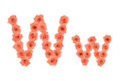 Marquez avec des lettres W, alphabet fait à partir des roses oranges Photo stock