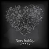 Marquez le coeur à la craie élégant avec des éléments de christmass au tableau noir Photographie stock libre de droits