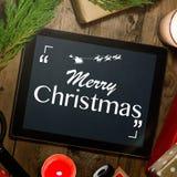 Marquez sur tablette faux avec un copyspace pour Noël Applica de Noël Photographie stock libre de droits