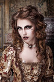 Marquise met moedervlek op haar gezicht stock afbeelding