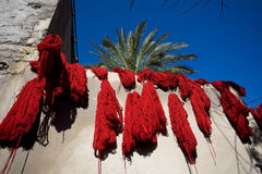 Marrakech. Red dye in souq of dyer Stock Photography