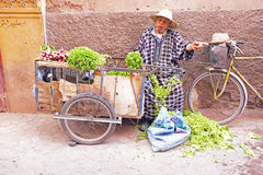 MARRAKECH, MOROCCO - OCTOBER 22:Maroccan man selling vegetables Royalty Free Stock Photos