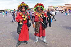 MARRAKECH, MOROCCO OCTOBER 23 2013: Water carriers at the market Royalty Free Stock Images