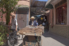 MARRAKECH, MOROCCO SEPT 9TH: A man pushing a cart through the so Royalty Free Stock Photo