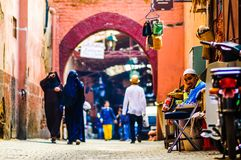 Marrakech, Morocco on 31th October 2015: Woman and locals in the in Souk of the old city stock image
