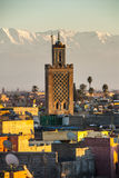 Marrakech in Morocco. View from the roof of the photography museum over Marrakech during sunset with the snow-covered Atlas mountains in the background and the Stock Image