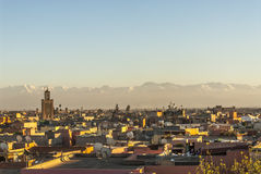 Marrakech in Morocco. View from the roof of the photography museum over Marrakech during sunset with the snow-covered Atlas mountains in the background and the Royalty Free Stock Photos