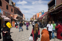 Marrakech street. Djemaa el-Fna square with Café Argana, mosque, bazaar and people - tourists and natives. Marrakech, Marocco Stock Image