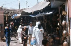 1974. Morocco. Marrakesh, bazaar. Cobberstreet. A bazaar street in Marrakesh, where mainly different types of cobber-ware are traded Royalty Free Stock Image