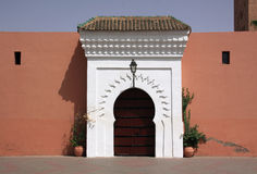 Marrakesh Islamic gate and terracotta wall Royalty Free Stock Image