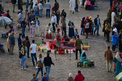 Marrakesh Jemaa el Fnaa square attractions. Various attractions and cooks offering fresh made food in Jemaa el Fnaa square in Marrakesh, Morocco, Africa Royalty Free Stock Photo