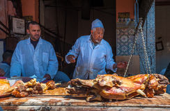 MARRAKESH, MOROCCO - April, 09, 2013: Sellers of roasted lamb in Stock Photography