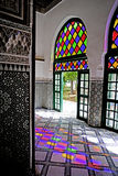 Colorful games of reflected light El Bahia Palace in Marrakesh stock image