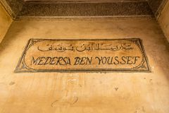 Ben Youssef Medersa sign in Marrakesh, Morocco Stock Photography