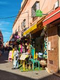 Street scene in the medina of Marrakesh, Morocco. Marrakesh, Morocco - December 8, 2016: Unidentified people at the Bakchich Cafe in Marrakesh, Morocco. It`s a Royalty Free Stock Images