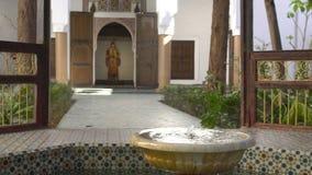 MARRAKESH, MOROCCO - JAN 20: Moroccan architecture traditional arabian design - Rich Riyad Dar Si Said mosaic interior. Beautiful Courtyard with fountain. 4k stock video footage