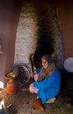 Marrakesh, Morocco - January 7,2017: Old woman cooking on her house. An old woman is cooking on her house in Morocco. The woman was cooking a tagine on the wood Royalty Free Stock Photography