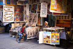 Marrakesh, Morocco - January 7, 2017: Paintings shop. Paintings shop with two shop assistants speaking on the streets of Marrakesh Royalty Free Stock Photo