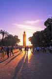 MARRAKESH, MOROCCO - Jemaa el Fna Square in front of the Koutoubia mosque at sunset. MARRAKESH, MOROCCO - OCTOBER 23: Unidentified people walk at the Jemaa el Stock Photos