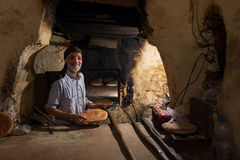 MARRAKESH ,MOROCCO - NOVEMBER 12: Unidentified man making traditional bread in Marrakesh Stock Images