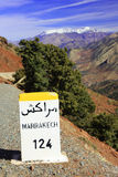 Marrakesh sign. A road sign for Marrakesh with the Atlas mountains in the background Stock Image