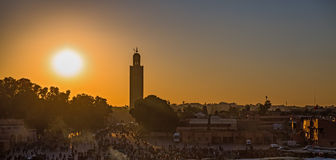 Marrakesh sunset. Wide view of Koutobia mosque at sunset, backlit in Marrakesh Royalty Free Stock Image