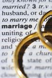 Marriage. Two wedding rings next to the word marriage on a english dictionary royalty free stock photo