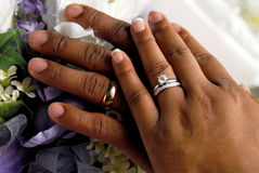 Marriage. A closeup of a bride and a groom's hands, with their wedding bands royalty free stock photos