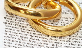 Marriage. The word marriage out of a dictionary with gold rings next to it Royalty Free Stock Images