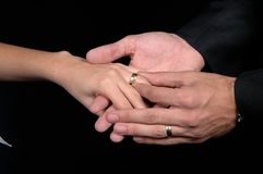 Marriage. Delicate hand of woman receiving engagement ring Stock Photos