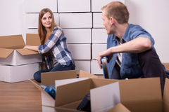 Marriage and boxes. Young moving out marriage packing the boxes stock photography