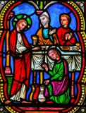 Marriage at Cana, Jesus& x27; first miracle in the Gospel of John. Stained Glass in the Cathedral of Monaco, depicting the transformation of water into wine at stock photography