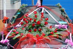 Marriage car. A table full of brightly colored roses wedding car Stock Photography