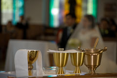 Marriage ceremony. Altar inside a Catholic chuch with bride and groom kneeling Royalty Free Stock Images