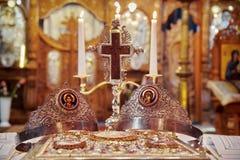 Marriage ceremony. Wedding ceremony in Orthodox church - Romania. Marriage ceremony. Holy Cross, Wedding Crowns and Gospel Book for wedding ceremony in orthodox Stock Photos