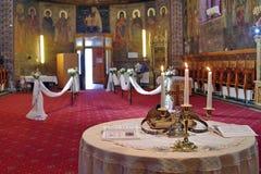 Marriage ceremony. Wedding ceremony in Orthodox church - Romania. Marriage ceremony. Orthodox church arranged for wedding ceremony - Romania Stock Photo