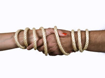 Marriage. Closeup of a woman's arm and another man, tied with a rope Stock Image