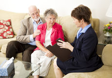 Marriage Counseling. Senior couple meets with a marriage counselor Stock Image