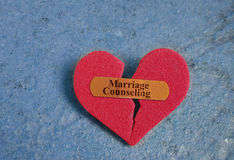 Marriage Counseling heart. Broken red heart with a Marriage Counseling bandaid Stock Photos