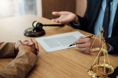 Marriage divorce on Judge gavel deciding, Consultation between a Businesswoman and Male lawyer or judge consult having yes or no royalty free stock photo